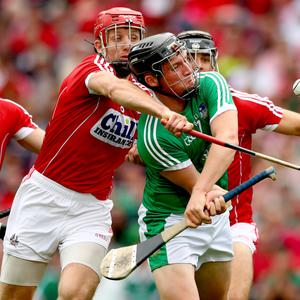 What a match: Limerick's Peter Casey is blocked by Cork's Bill Cooper in the All-Ireland semi-final at Croke Park, an encounter hailed as an all-time classic