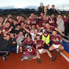 Just champion: Cushendall players celebrate after winning the Ulster title