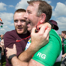 High point: Fermanagh goalkeeper coach Ronan Gallagher celebrates with former player Martin McGrath after the Ulster semi-final success over Monaghan in June
