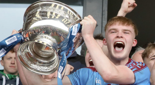 Silver lining: Brandon Horan lifts the trophy for St Michael's