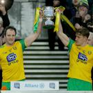 Big lift: Donegal captain Michael Murphy (left) collects the Division Two title with Hugh McFadden