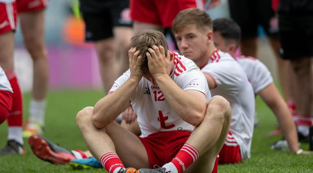 Tough to take: Tyrone's Kieran McGeary dejected after the defeat against Dublin last year