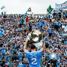 Silver service: Dublin's Philip McMahon lifts Sam Maguire after the triumph over Tyrone in last year's decider