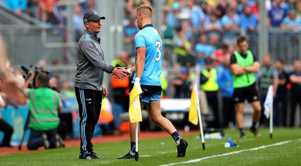 Marching orders: Dublin coach shakes Jonny Cooper's hand after he was sent off in the drawn final