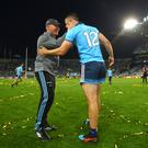 High fives: Manager Jim Gavin and Brian Howard after Dublin clinched the Sam Maguire for the fifth successive time
