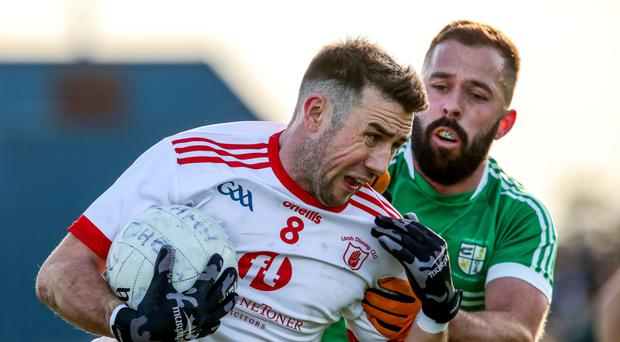 Pressure on: Lamh Dhearg's Conor Murray holds off Martin Kane