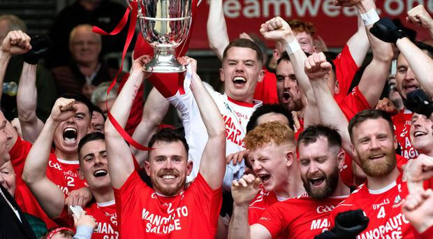 Party time: Trillick celebrate winning the Tyrone title, but the attendance was down on the last time they reached the final