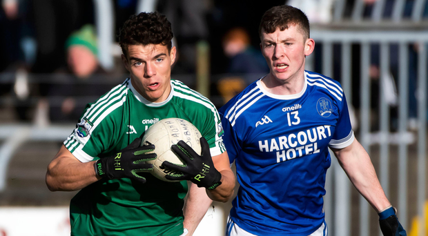 Heat on: Gaoth Dobhair's Odhran McFadden-Ferry takes on Naomh Conaill's Jack McConnell yesterday