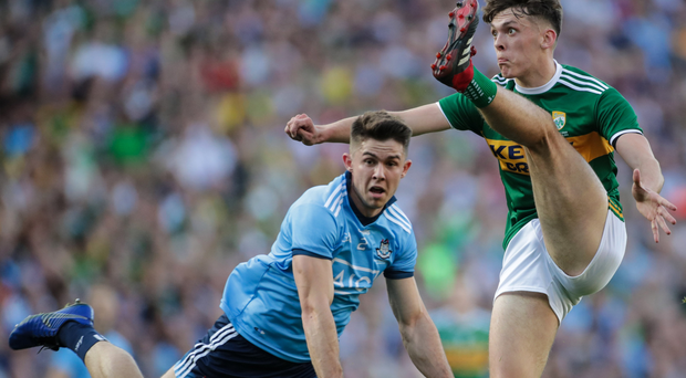 Kicking out: Kerry ace David Clifford scores a point past Dublin's David Byrne in the All-Ireland final replay
