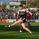 Cutting edge: Jerome Johnston (right) scores a crucial second-half goal yesterday for Kilcoo at Pairc Esler, Newry