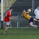 Hands on: Derrygonnelly ace Jack Love dives for one of the penalties