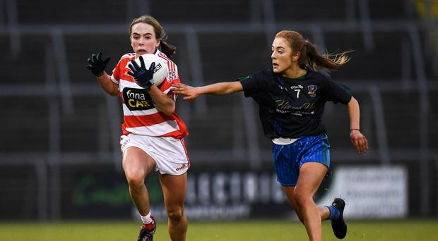 Pressure on: Niamh Enright of St Paul's in action against Ffion Boland of Naomh Ciaran
