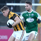 Making strides: Crossmaglen's Oisin O'Neill gets away from Cian O'Maolagain of Gweedore