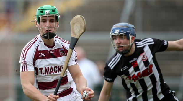 Close attention: Slaughtneil's Shane McGuigan is pursued by Middletown's Peadar Kearney yesterday