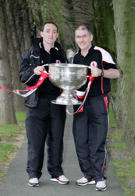 Champions: Mickey Harte with Brian Dooher pose with the Sam Maguire Cup in 2005