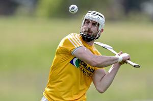 Testing the water: Antrim hurler Neil McManus looks forward to a post-training dip in Red Bay