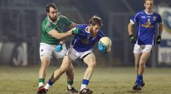 Cavan's Rory Dunne retains possession despite the attentions of Fermanagh's Sean Quigley