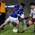 Cavan's Darragh Kennedy with Lee Brennan of Tyrone