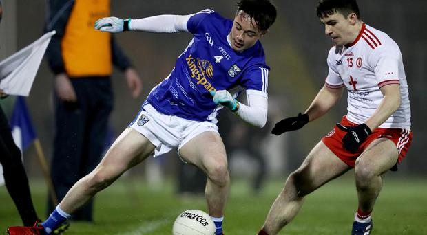 Cup clash: Cavan's Darragh Kennedy with Lee Brennan of Tyrone