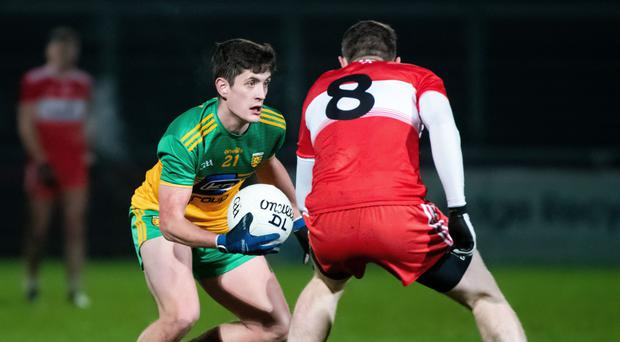 Going through: Donegal's Ethan O'Donnell battles with Derry's Emmett Bradley
