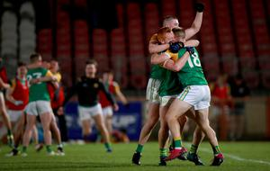 Dungannon's Matthew Walsh, Oran Mallon and Kiefer Morgan celebrate at the final whistle on Saturday night