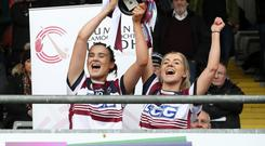 Winners: Slaughtneil joint captains Siobhan Bradley (left) and Grainne Ni Chathain lift the cup