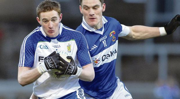 Ballinderry's Kevin McGuckin and St. Vincent's ace Hugh Gill in action at Saturday's game