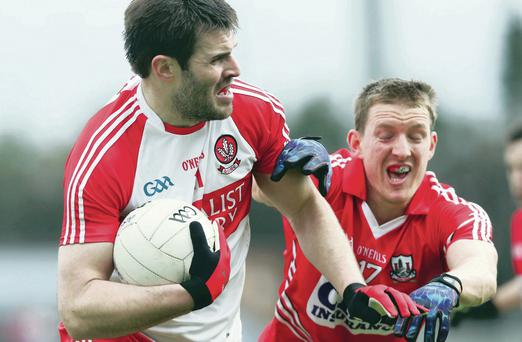 Mark Lynch of Derry is challenged by John McLoughlin