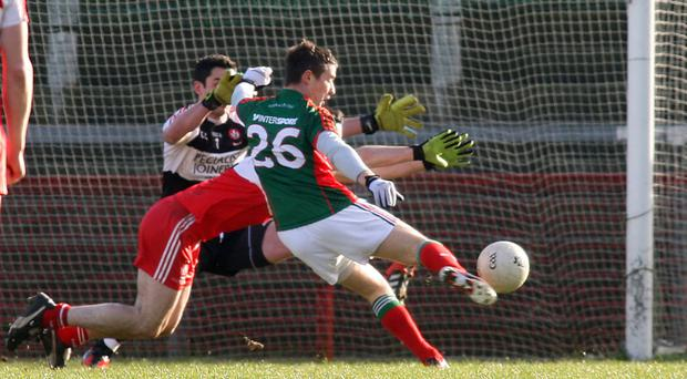 On target: Derry can't prevent Mayo's Mickey Sweeney finding the net at Celtic Park