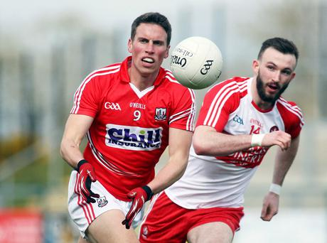 Race on: Cork's Paddy Kelly with Derry's Terence O'Brien