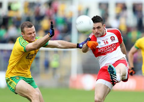 Closed down: Derry's Eoin Bradley is challenged by Neil McGee