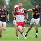 Front foot: Derry's Fergal Doherty races clear of Wexford's Tiernan Rossiter and Graeme Molloy at Owenbeg