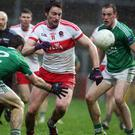 Eyes on prize: Derry's James Kielt and Fermanagh's Mickey Jones (left) battle it out yesterday at Celtic Park