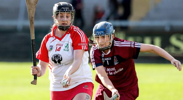 Close watch: Loughgiel's Racquel Murphy is put under pressure by Jolene Bradley of Slaughtneil