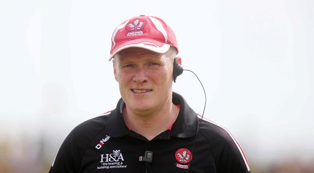 Big test; Derry manager Damian McErlain has plumped for a fusion of youth and experience against Tyrone tonight