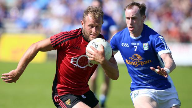 Power play: Darren O'Hagan's surging runs and defensive ability can still bolster Down's promotion bid