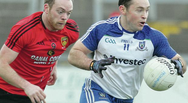 Down's Ryan Mallon pursues Monaghan's Stephen Gollogly