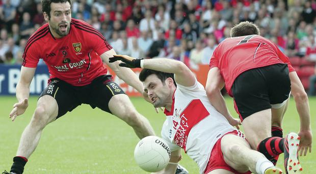 Down's Kevin McKernan is pleading for a review of the Ulster Championship format to end his team's away-day saga