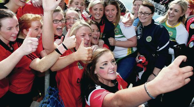 Jubilant: Down players celebrate with a 'selfie' after the game