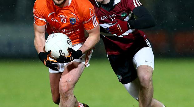 Having a ball: Armagh's Stefan Forker trys to hold off a challenge from St Mary's ace Matt Fitzpatrick