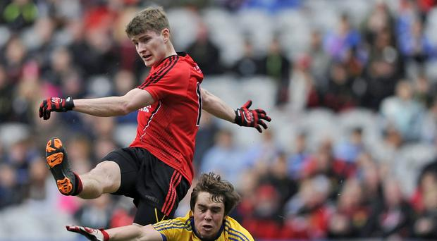 Closed down: Down's Conor Maginn is put under pressure by David Murray