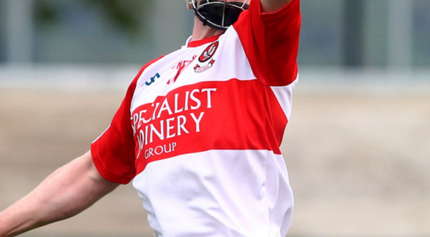 Top man: Derry's Paul Cleary in control against Down