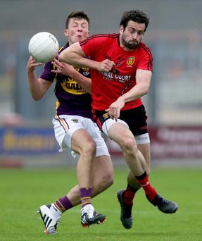 Up close and personal: Eoghan Nolan of Wexford is challenged by Kevin McKernan in the All-Ireland first round qualifier