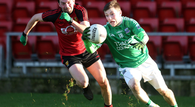 On the ball: Fermanagh ace Daniel Teague tries to shake off Down's Damien Turley