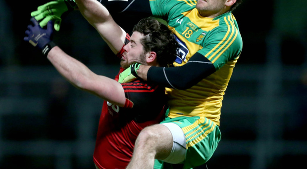 Heat of battle: Down's Niall Madine under pressure from Donegal's Eamon McGee in Pairc Esler