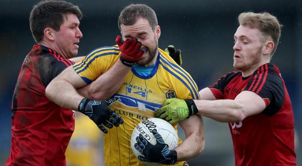Sandwich: Down duo Peter Turley (left) and Gerard McGovern try to close down Roscommon's Senan Kilbride at Pearse Park