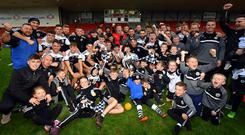 Joy day: Kilcoo players and fans lap up their seventh Down title coup in eight years.