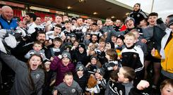 All-Ireland dream: Kilcoo celebrate their Ulster Club win over Naomh Conail