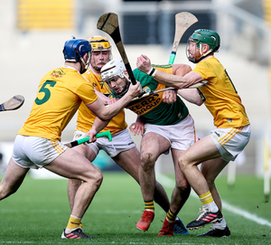 Surrounded: Antrim's Gerard Walsh, Joe Maskey and Niall McKenna close in on Jason Diggins of Kerry