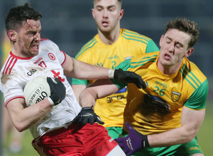 Gripping game: Tyrone's Matthew Donnelly battles with Donegal's Hugh McFadden
